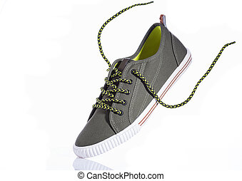 Green sneakers on a white background