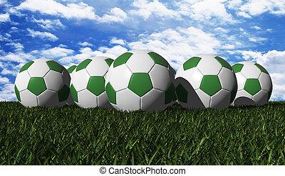 Green soccer ball on a green grass