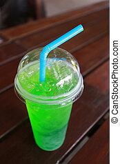 Green soda soft drink in glass.