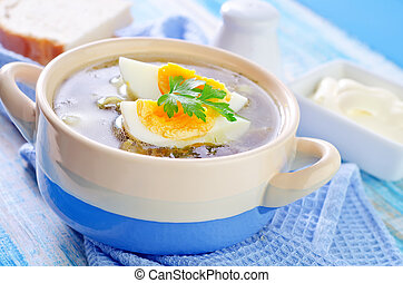 green soup with boiled eggs