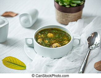 green soup with meat balls
