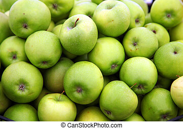 Green sour apples in the stock
