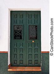 green spanish wooden door