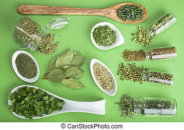 Green spices on a green background