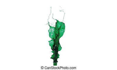 green splash flies into the camera in slow motion. oil