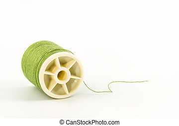 Green spools of sewing thread
