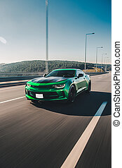 Green sport sedan high speed drive