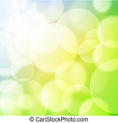 Green spring background with blurry light