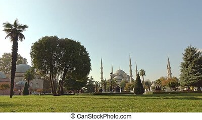 Green square with fountains near Sultan Ahmed Mosque Blue mosque in Istanbul, Turkey in a sunny day. 4K UHD video, 3840, 2160p.