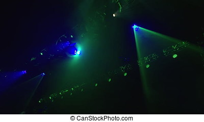 Green Stage Lights slowing moving across camera