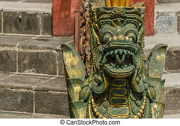 green statue of a buddhist temple