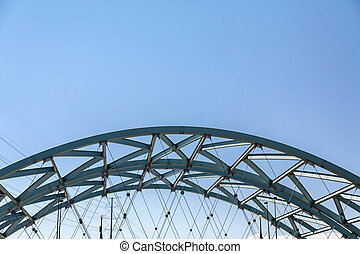 Green Steel Arch Over Denver Bridge