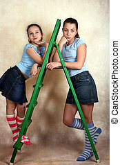 Green step-ladder - Portrait of the young girls with...