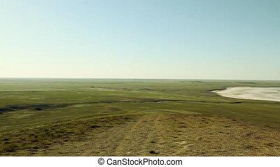 green steppe and salt lake Baskunchak at sunny day