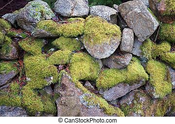 green stone wall weathered