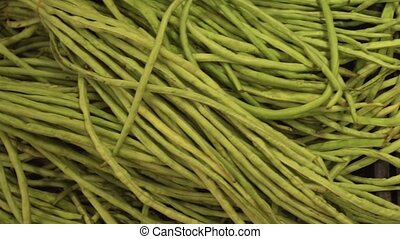 Green string beans and radish sold in supermarket stock...