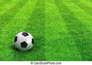 Green striped football field with soccer ball - Close view...