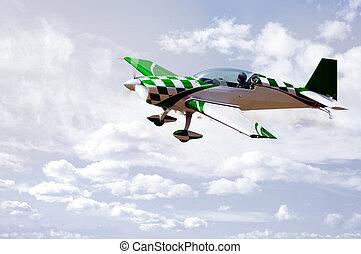 Green Stunt Plane - A green Extra Flugzeugbau gmbH aerobatic...