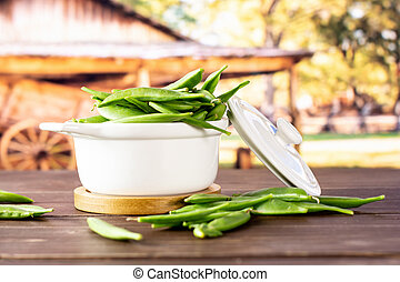 Green sugar snap pea with cart - Lot of whole fresh green ...