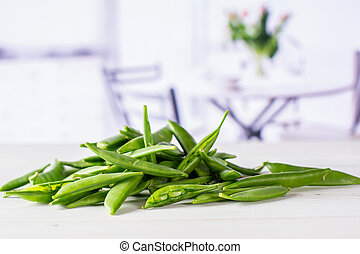 Green sugar snap pea with red tulips - Lot of whole green ...