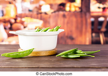 Green sugar snap pea with rustic kitchen - Lot of whole ...