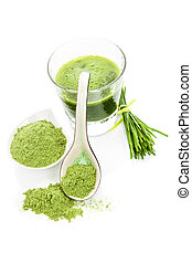 Green superfood. Green drink, ground wheat grass on spoon isolated on white background. Healthy food supplement.