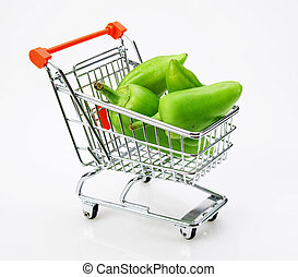 Green sweet pepper paprika in shopping trolley on white...