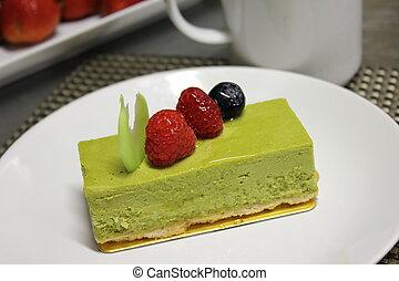 green tea cheese cake ontop raspberry,bluberry