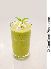 Green tea frappe, topping with peppermint leaf