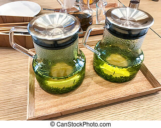 Green tea in jug on tray