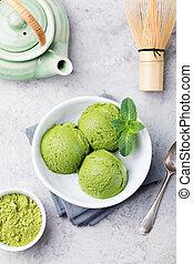 Green tea matcha ice cream scoop in bowl. Top view
