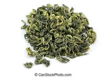 green tea - dried green tea leaves on white