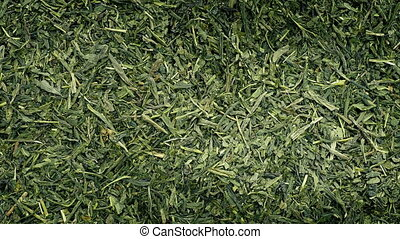 Green Tea Rotating - Overhead shot of dried green tea leaves...