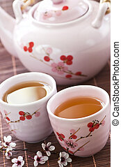 Green tea set with teapot and cups
