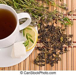 green tea with herbs, lemon and sugar