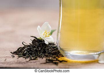 Green tea with jasmine. Tea in a glass.