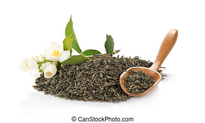 Green tea, wooden spoon and blossoming jasmine