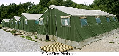 Green tent camp in Pyrenees for Santiago pilgrims - Green...