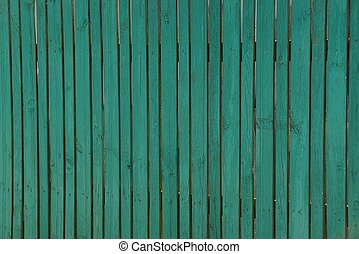 Green texture of an old wooden fence