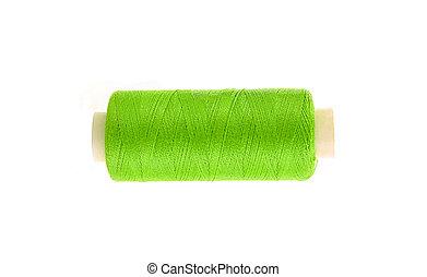 green thread bobbin isolated on white background