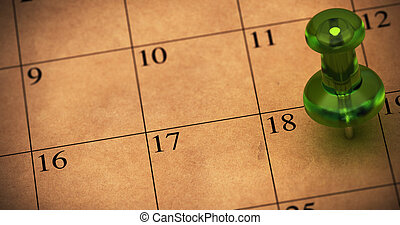 Green thumbtack onto a schedule made with recycled brown ...