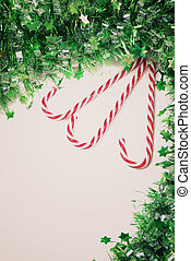 Green tinsel with candy canes decoration, retro toned