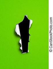 Green torn paper with black hole