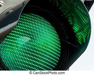 green traffic light - a traffic light road traffic shows...