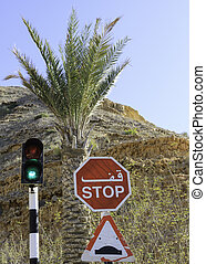 Green traffic light and stop sign