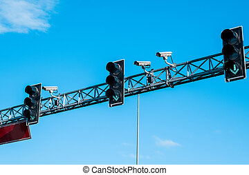Green traffic lights and cameras againts blue skies - Green ...