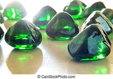 green translucent stones on white background