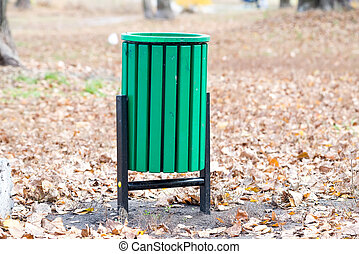 Green Trash Bin in the Park