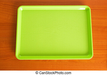 Green tray on the wooden table