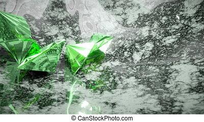 Green trillion cut diamonds falling